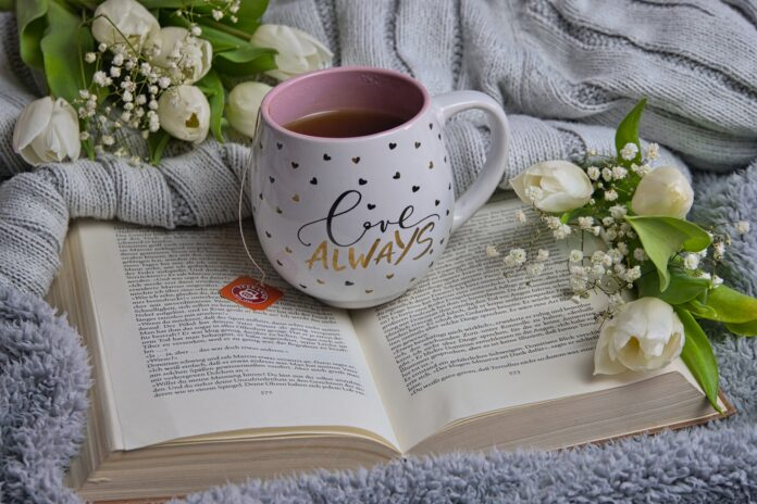 Book and cup of tea, for a post about writers who inspire me
